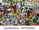 Small photo of PRAGUE, CZECH REPUBLIC - MARCH 03. 2015: The Lennon Wall since the 1980s is filled with John Lennon-inspired graffiti and pieces of lyrics from Beatles songs on March 03, 2015 in Prague.