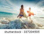 two ladies running into the sea ... | Shutterstock . vector #337204505
