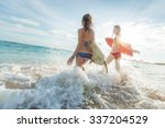 two ladies running into the sea ... | Shutterstock . vector #337204529