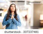 happy young woman praying | Shutterstock . vector #337237481