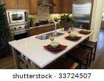 luxury kitchen with a granite... | Shutterstock . vector #33724507