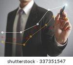 businessman drawing graphics a... | Shutterstock . vector #337351547