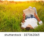 young woman enjoying a book... | Shutterstock . vector #337362065