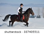 Young Man Riding Horse Outdoor...