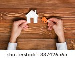 hands holding paper house... | Shutterstock . vector #337426565