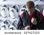 boy is putting on the driving... | Shutterstock . vector #337427225