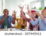 creative team tossing paper in... | Shutterstock . vector #337445411