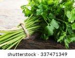 fresh parsley on wooden... | Shutterstock . vector #337471349