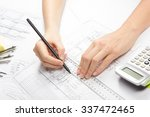 architect working on blueprint. ... | Shutterstock . vector #337472465