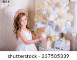child decorate white christmas... | Shutterstock . vector #337505339