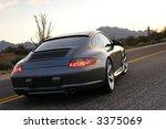 sportscar in the setting sun | Shutterstock . vector #3375069