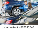 young mechanic discussing with... | Shutterstock . vector #337519865