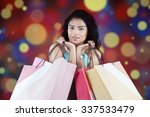 indian woman looking at the... | Shutterstock . vector #337533479