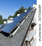 Small photo of Hot water solar heating system - Solar panels on the roof - green energy, renewable energy, alternative energy - vertical image - nobody