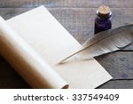 Small photo of Writing concept. Closeup of scroll and quill near ink-pot on wooden table