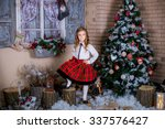 beautiful baby girl  wearing a... | Shutterstock . vector #337576427