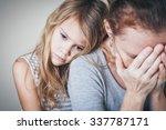 sad daughter hugging his mother ... | Shutterstock . vector #337787171