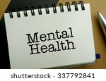 Mental health memo written on a notebook with pen - stock photo