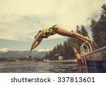 Woman Diving Off The Dock Of...