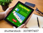 hands of a man gaming solitaire ... | Shutterstock . vector #337897607