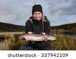 Young Smiling Woman Fishing A...