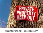 red keep out sign nailed to... | Shutterstock . vector #33803839