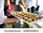 waiter carrying plates with... | Shutterstock . vector #338044841