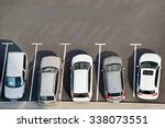 Stock photo view from above of car parking full of vehicles 338073551