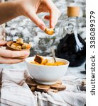add croutons in pumpkin soup... | Shutterstock . vector #338089379