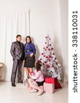 family with gifts near...   Shutterstock . vector #338110031