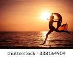 happy girl jumping on the beach ... | Shutterstock . vector #338164904