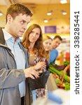 embarrassed man at supermarket... | Shutterstock . vector #338285441