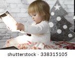 happy little girl at christmas. ... | Shutterstock . vector #338315105
