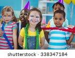 happy kids enjoying a birthday... | Shutterstock . vector #338347184
