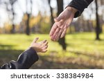 mother and son holding hand | Shutterstock . vector #338384984