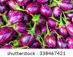 Small photo of Close-up view group of fresh organic raw ripe Eggplant (or Brinjal) on display at Vegetable Stall of Local Market at Little India, Sinagpore. Colourful vegetable background and healthy concept