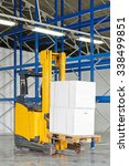forklift truck with boxes at... | Shutterstock . vector #338499851