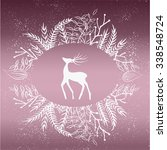 card with deer in wheath... | Shutterstock .eps vector #338548724