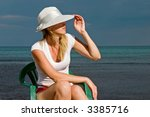 the woman sits on a sea... | Shutterstock . vector #3385716