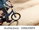 A Child On A Bicycle In Part O...