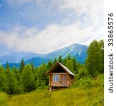 landscape with wooden house in mountains - stock photo