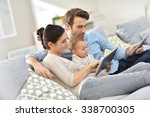 family with baby in sofa... | Shutterstock . vector #338700305