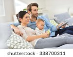 family with baby in sofa... | Shutterstock . vector #338700311