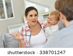 man and woman arguing in front... | Shutterstock . vector #338701247