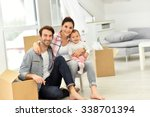 Young Family Moving Into New...