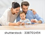 parents with baby girl playing... | Shutterstock . vector #338701454