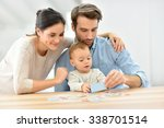parents with baby girl playing... | Shutterstock . vector #338701514