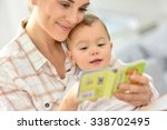 sweet moment with mother... | Shutterstock . vector #338702495