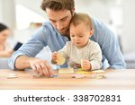man playing with baby girl at... | Shutterstock . vector #338702831