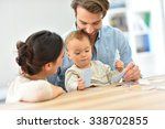 parents with baby girl playing... | Shutterstock . vector #338702855